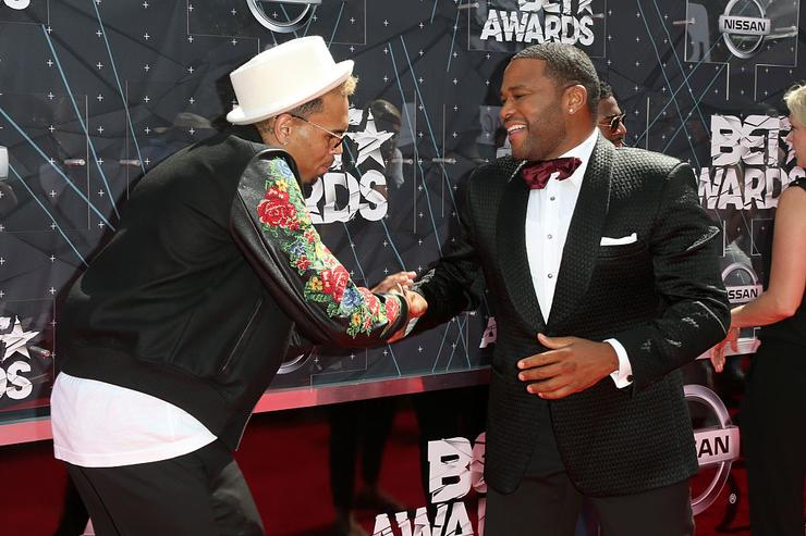Chris Brown (L) and co-host Anthony Anderson attend the 2015 BET Awards at the Microsoft Theater on June 28, 2015 in Los Angeles, California.