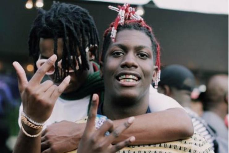 (L-R) Playboi Carti and Lil Yachty embrace at a show.