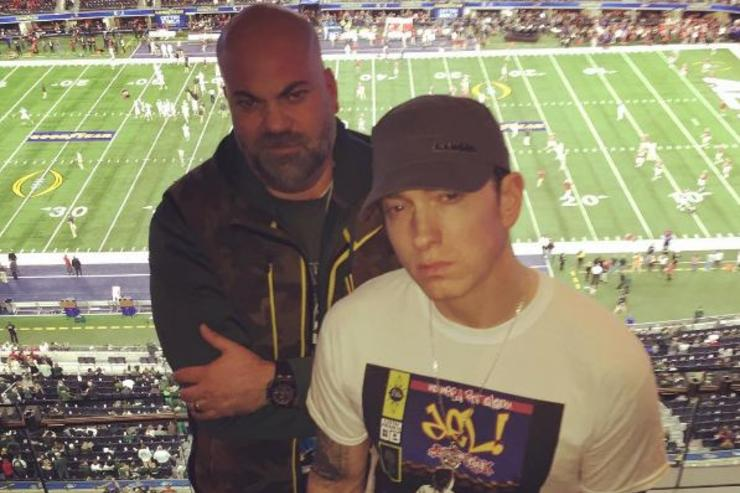 Paul Rosenberg and Eminem hang out at the 2015 Cotton Bowl