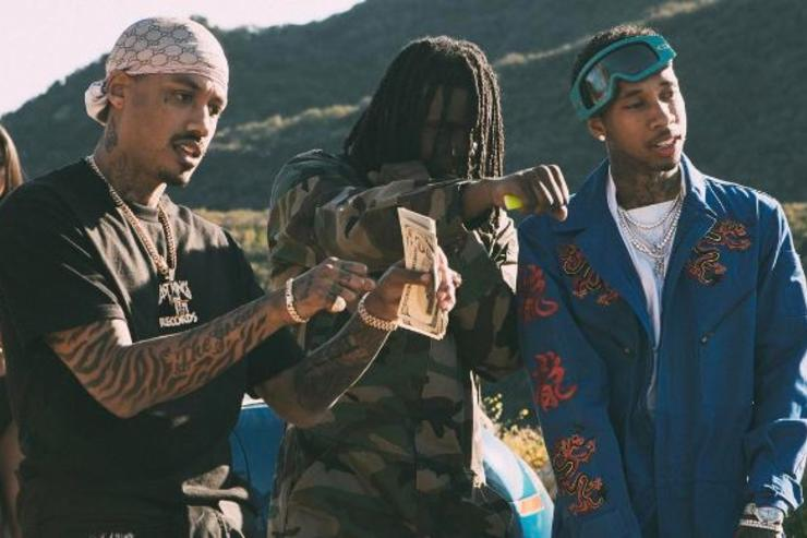 A.E, Chief Keef & Tyga pose on the set on their latest music video.