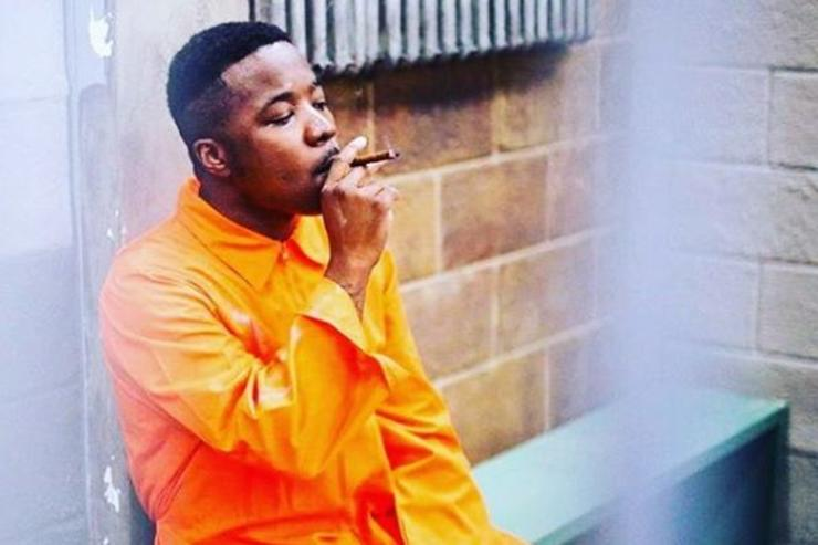Troy Ave smokes in a jail cell.