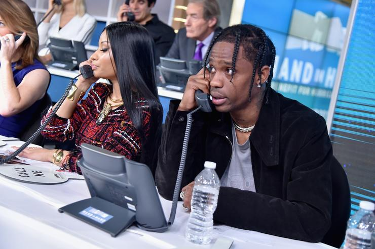 In this handout photo provided by Hand in Hand, Nicki Minaj and Travis Scott caption at ABC News' Good Morning America Times Square Studio on September 12, 2017 in New York City.