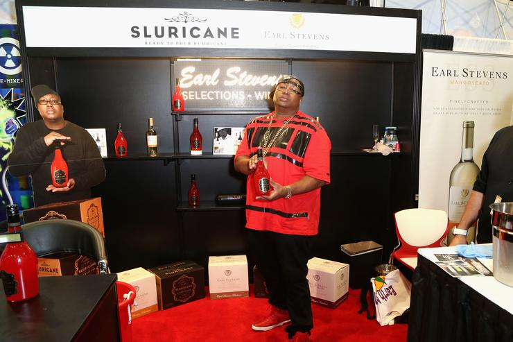 E-40 poses in the Earl Stevens Selections booth during the 30th annual Nightclub & Bar Convention and Trade Show at the Las Vegas Convention Center on March 31, 2015 in Las Vegas, Nevada.
