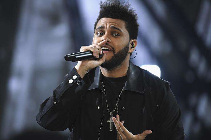 Weeknd performs during the runway at the Victoria's Secret Fashion Show on November 30, 2016 in Paris, France.