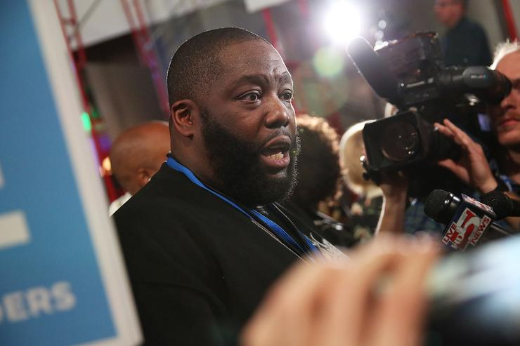 Rapper Killer Mike speaks to reporters in support of Bernie Sanders in the spin room after watching Sanders participate tonight's presidential debate at the Gaillard Center on January 17, 2016 in Charleston, South Carolina. Democratic presidential hopefuls Hillary Clinton, Bernie Sanders and Martin O'Malley spent yesterday campaigning in South Carolina in lead up to tonight's debate.