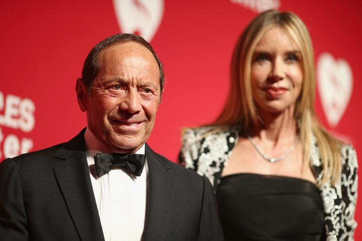 Singer Paul Anka (L) and guest attend the 2016 MusiCares Person of the Year honoring Lionel Richie at the Los Angeles Convention Center on February 13, 2016 in Los Angeles, California.