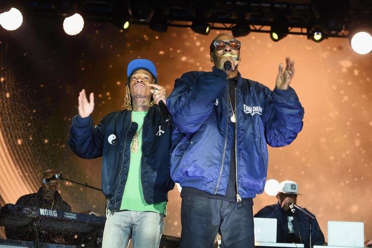 Wiz Khalifa and Snoop Dogg perform onstage at the AOL NewFront 2016 at Seaport District NYC on May 3, 2016 in New York City