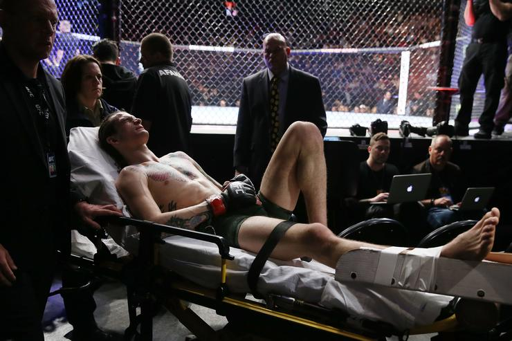 Sean O'Malley leaves the arena on a stretcher after injuring his lower right leg during a bantamweight bout against Andre Soukhamthath during UFC 222 at T-Mobile Arena on March 3, 2018 in Las Vegas, Nevada