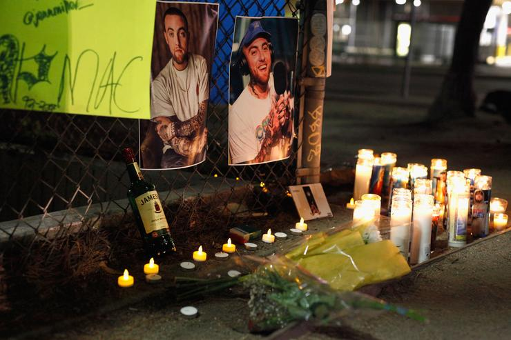A makeshift memorial for late rapper Mac Miller appears at the corner of Fairfax and Melrose Avenues on September 8, 2018 in Los Angeles, California.