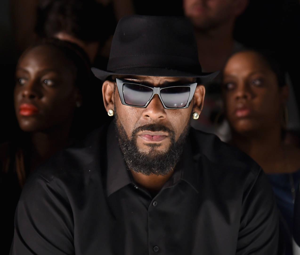 R Kelly charged with 10 counts of sex abuse