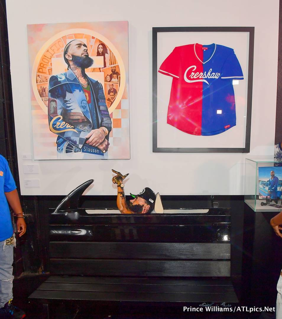 T.I. Unveils 3-Piece Nipsey Hussle Art Installation At Trap Music Museum