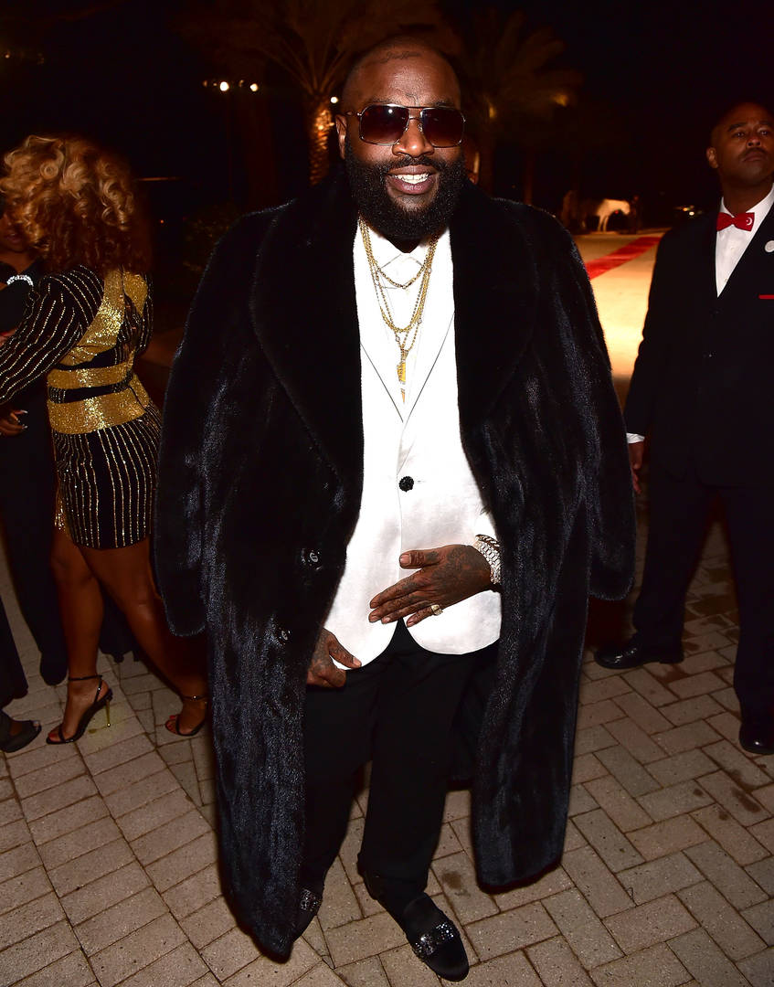 Rick Ross Gracefully Blows Kiss To Anti-Fur Protestors Ahead Of Book Signing