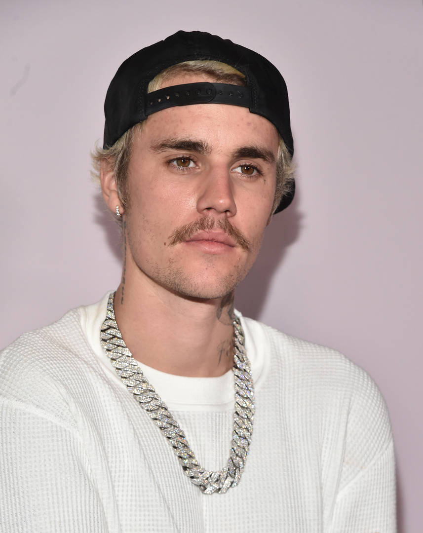 Justin Bieber shaves mustache changes album wife
