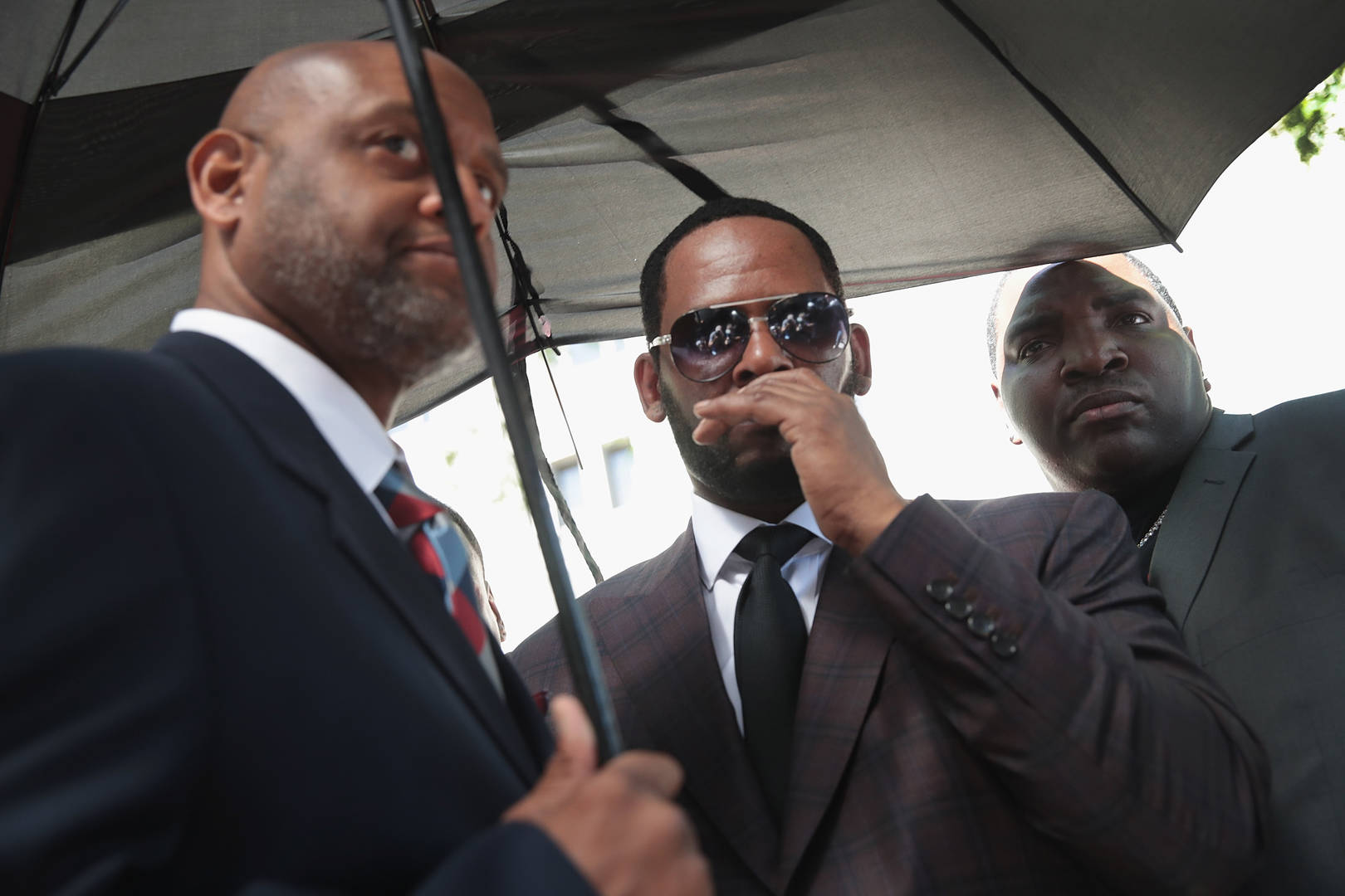 R. Kelly accusers threatened Donnell Russell Michael Williams Richard Arline Jr. charged