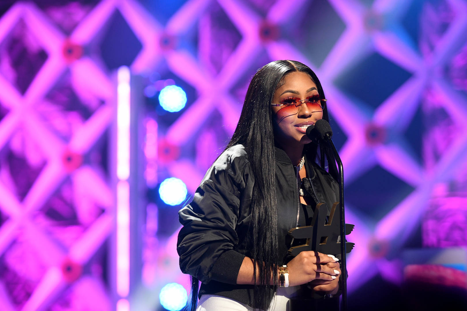 Yung Miami accepts an award onstage during the 2019 BET Social Awards at Tyler Perry Studio on March 3, 2019 in Atlanta, Georgia.