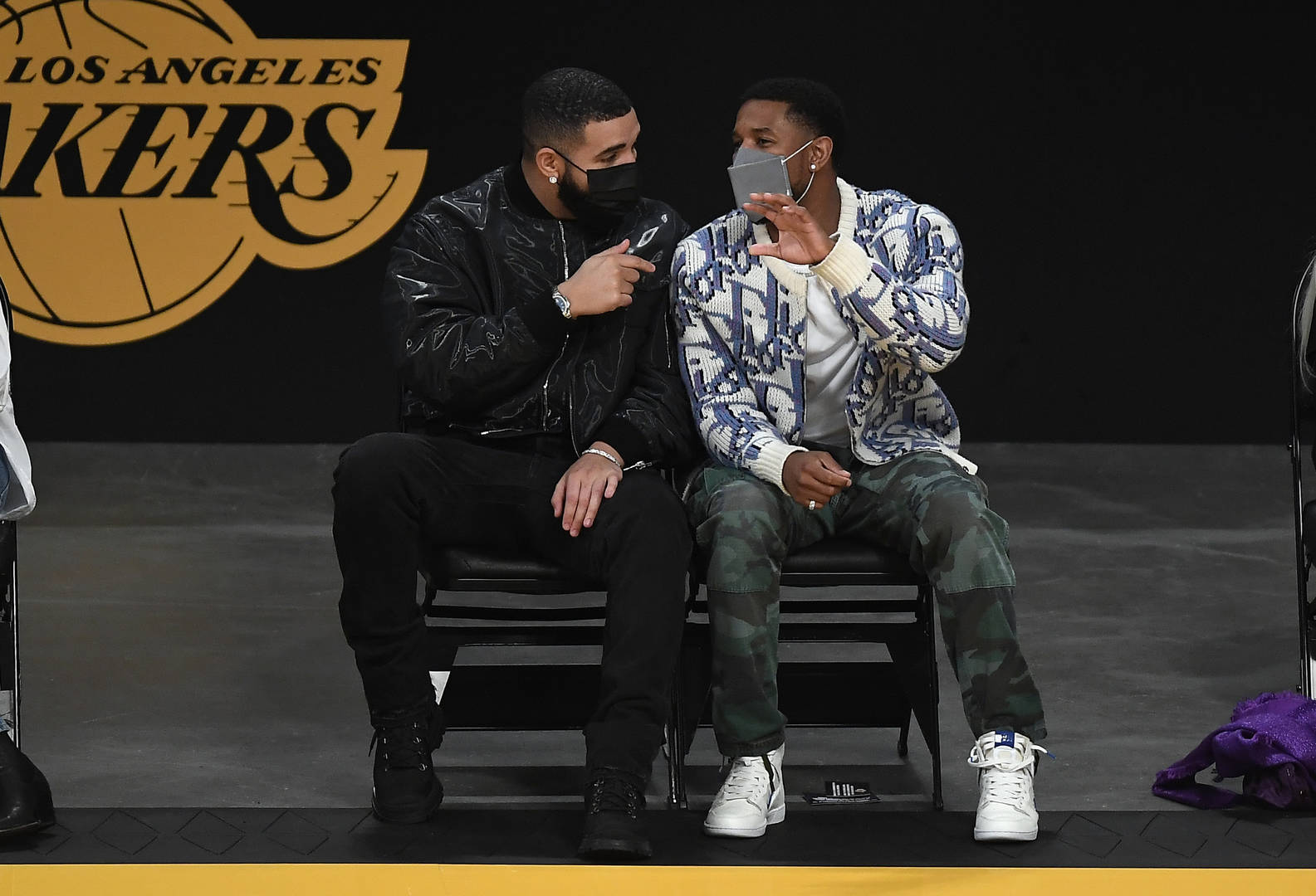Rapper and musician Drake (L) and actor Michael B Jordan attend the NBA Play-In Tournament game between the Los Angeles Lakers and Golden State Warriors at Staples Center on May 19, 2021 in Los Angeles, California.