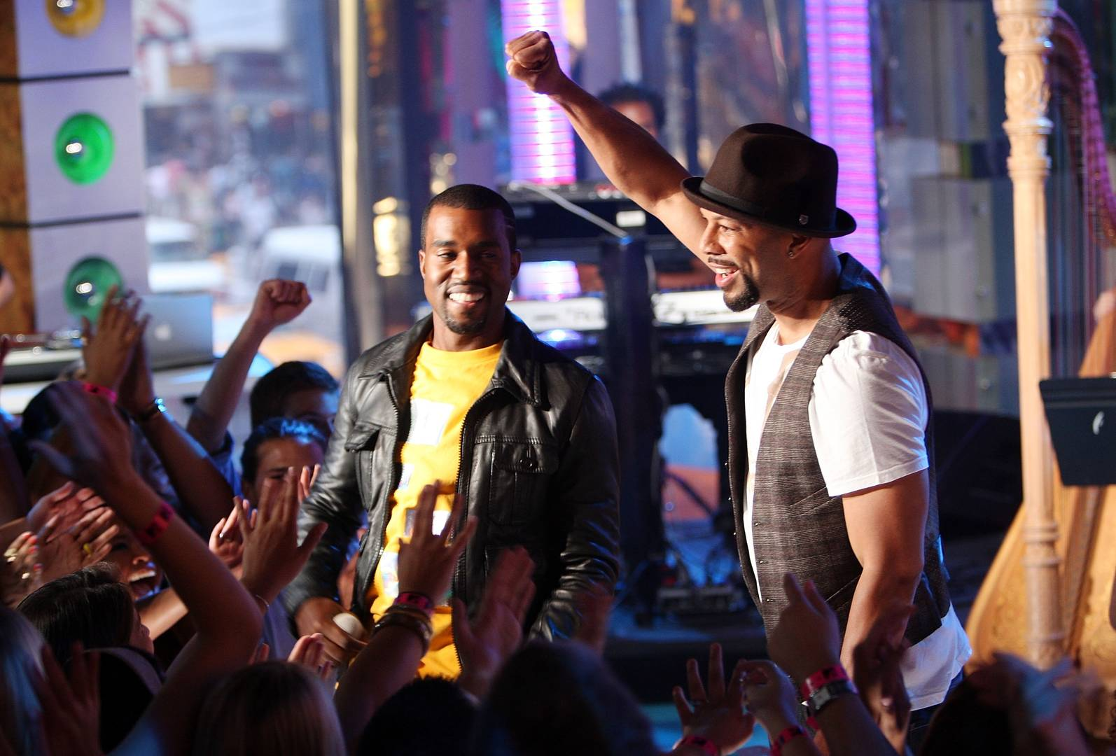 Rapper Kanye West (L) and Hip Hop artist Common perform onstage during a special Video Music Awards nominee taping of MTV's Total Request Live August 7, 2007 in New York City.
