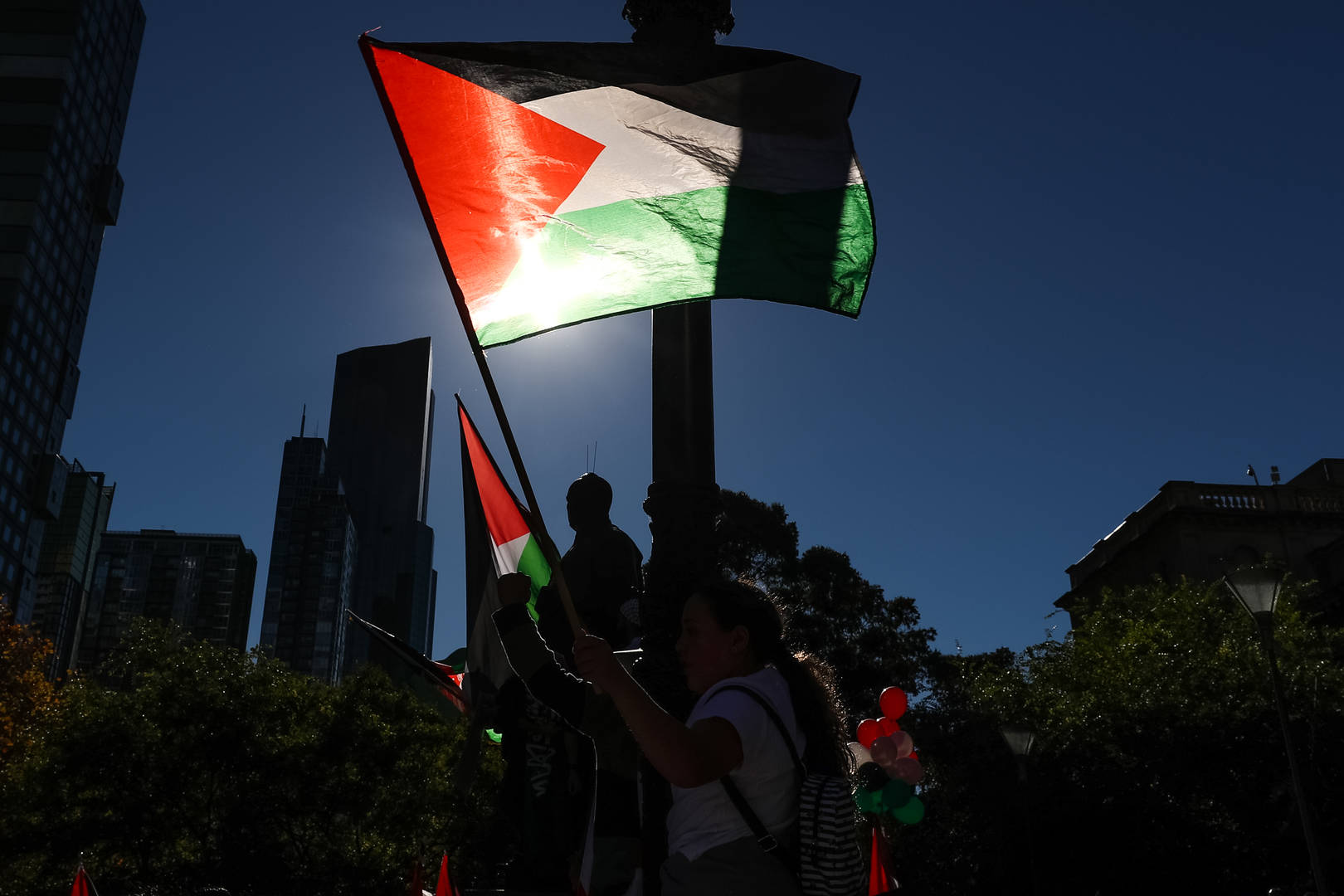 A Palestinian flag is waved during a Rally on May 22, 2021 in Melbourne, Australia. Rallies were organised across Australia to protest against the recent violence in Israel and the Gaza strip. A ceasefire between Israel and Hamas in Gaza started on Friday, following 11 days of rocket attacks.
