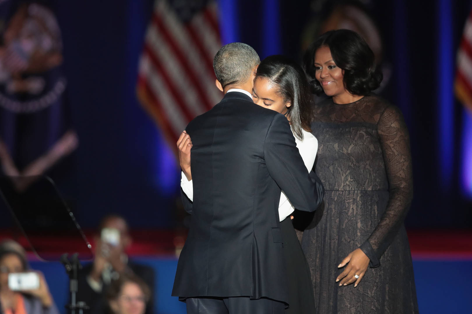 President Barack Obama greets his wife Michelle and daughter Malia following his farewell speech to the nation on January 10, 2017 in Chicago, Illinois. President-elect Donald Trump will be sworn in the as the 45th president on January 20.