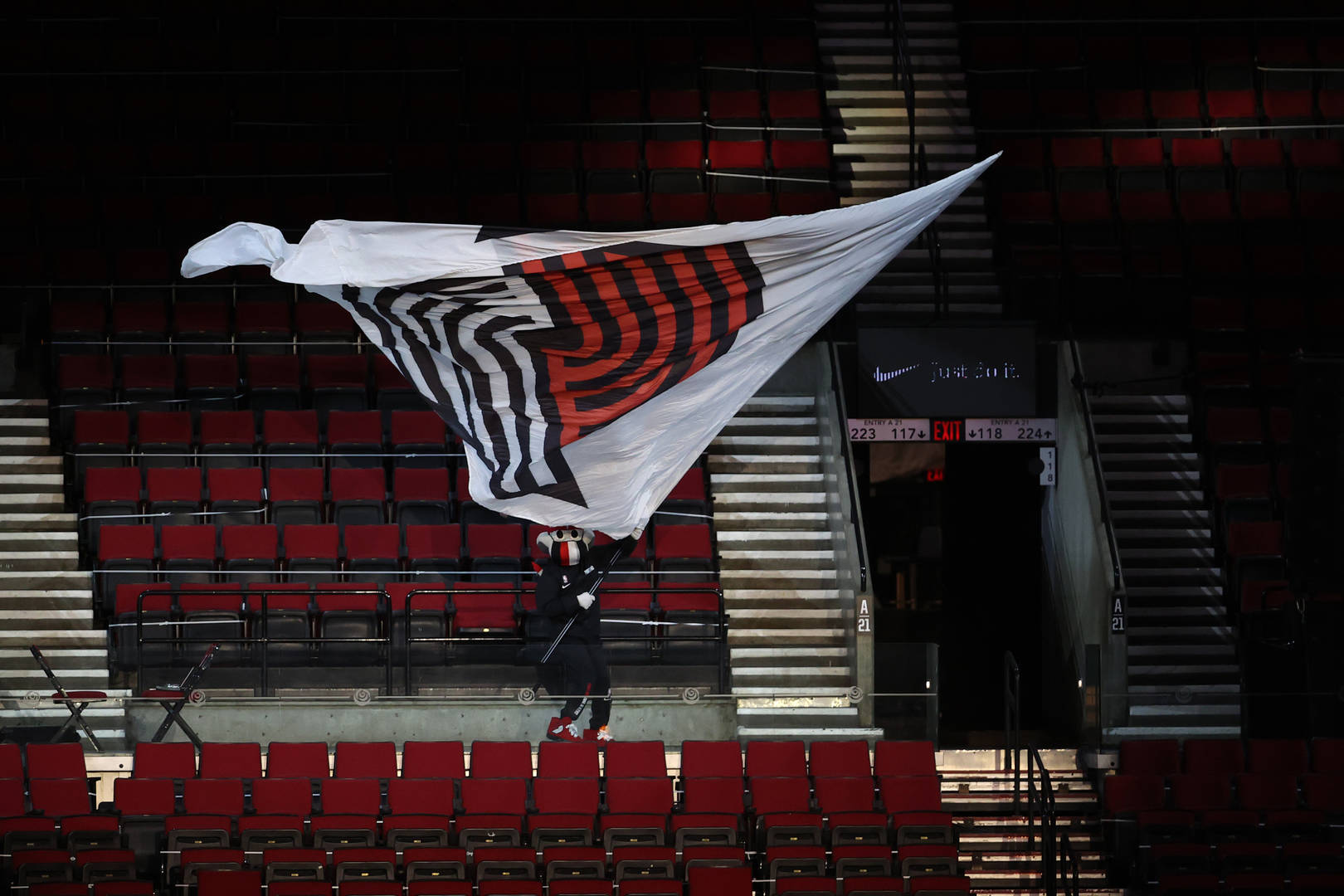 Portland Trail Blazers mascot, Blaze the Trail Cat, waves the team flag during a game against the Boston Celtics at Moda Center on April 13, 2021 in Portland, Oregon.