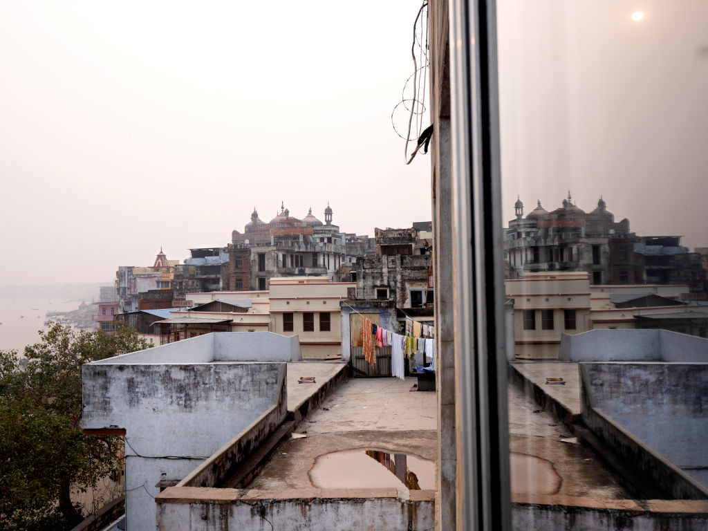 Looking out on Varanasi, India on January 07, 2019. Thousands of widows flock to Varanasi, a holy city in the crescent-shaped bank of India's Ganges River, often in escape of family that has become abusive or neglectful after the loss of their husbands, or from isolating superstitions that paint them as unlucky and unworthy. In the ashrams they find shelter, a daily meal, and a community of women of the same circumstance - in other words, a second home.