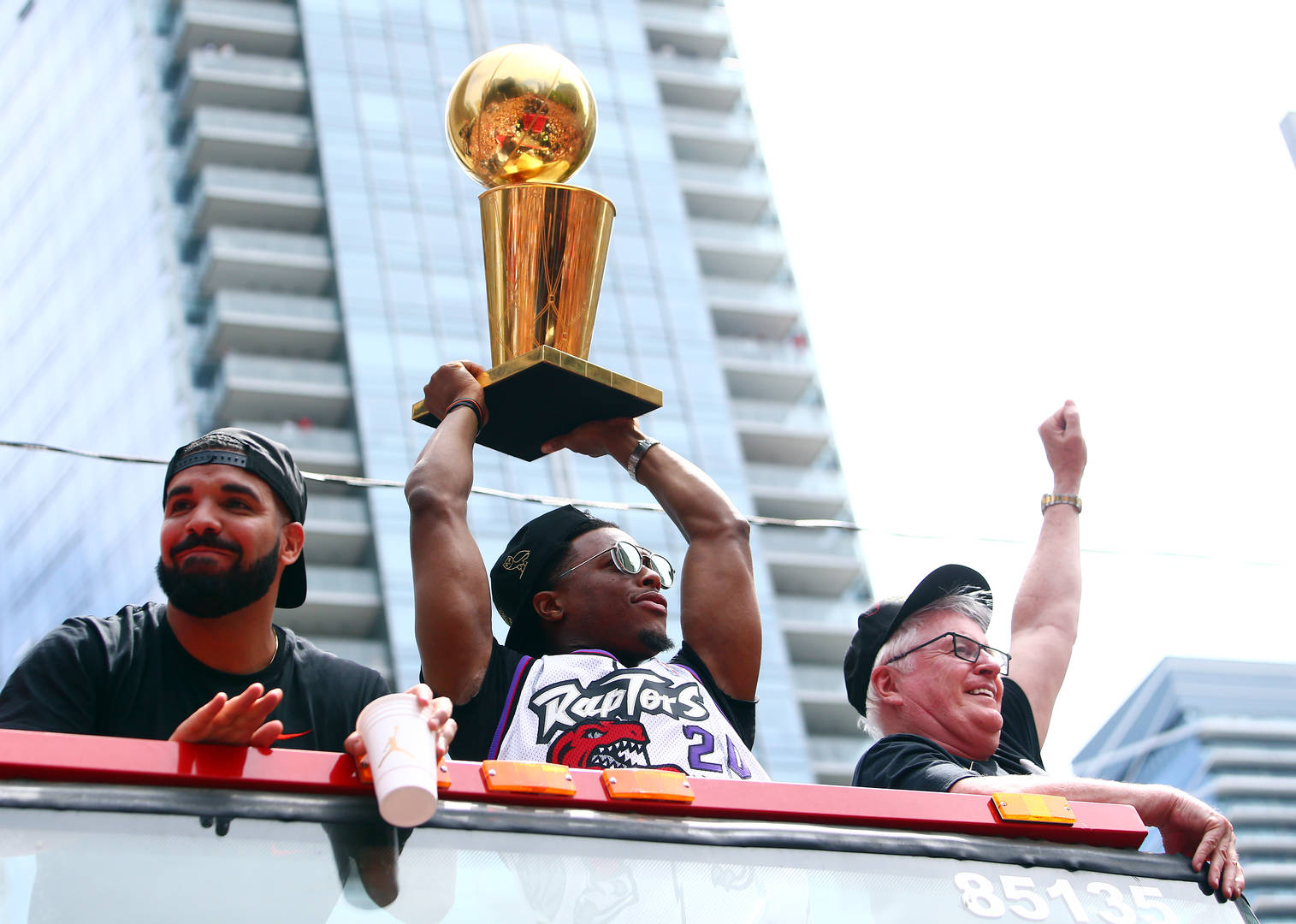 Drake and Kyle Lowry #7 of the Toronto Raptors holds the championship trophy during the Toronto Raptors Victory Parade on June 17, 2019 in Toronto, Canada. The Toronto Raptors beat the Golden State Warriors 4-2 to win the 2019 NBA Finals.