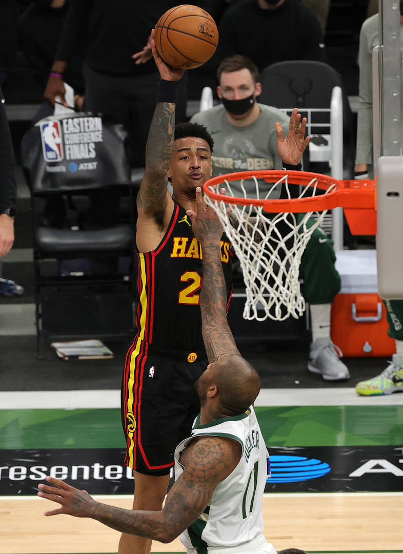 John Collins #20 of the Atlanta Hawks shoots over P.J. Tucker #17 of the Milwaukee Bucks during the second half in Game Five of the Eastern Conference Finals at Fiserv Forum on July 01, 2021 in Milwaukee, Wisconsin.