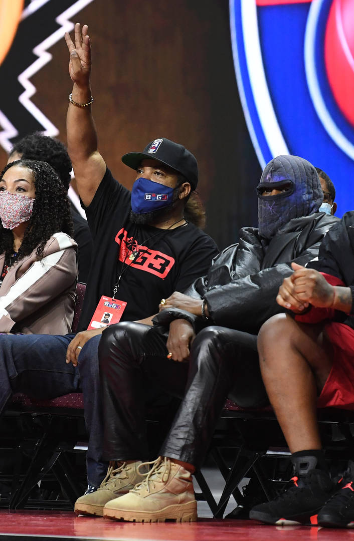 Ice Cube and Kanye West look on during a game between Killer 3's and 3's Company in the second week of the BIG3 at the Orleans Arena on July 17, 2021 in Las Vegas, Nevada.