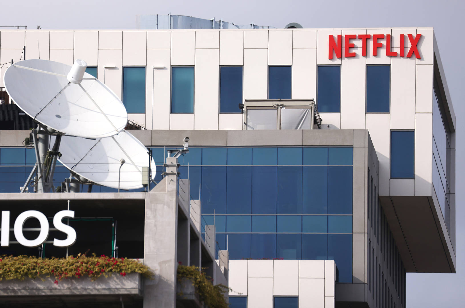 The Netflix logo is displayed at Netflix's Los Angeles headquarters (TOP) on October 07, 2021 in Los Angeles, California. The IATSE union which represents Hollywood's film and television production crews voted to authorize a strike, calling for better working conditions and higher pay amid a surge in streaming demand. Negotiations are ongoing but a strike may be imminent.